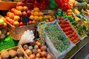 boxes of fresh fruits and vegetables in the market