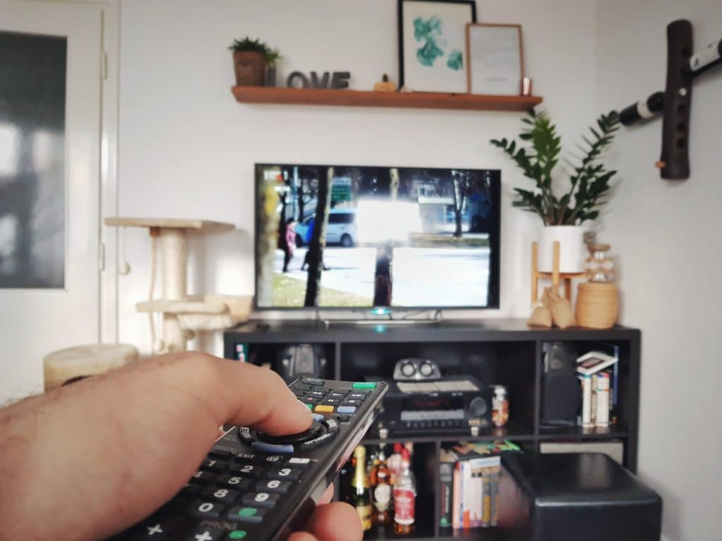 Hand on tv remote